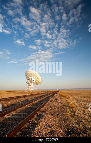 Radio telescope and tracks, Very Large Array (VLA), San Agustin Plains, near Magdalena, New Mexico USA - Stock Photo