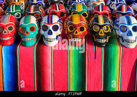 Porcelain skulls decorated in American football colours, set out as part of the Day of the Dead, Puerto Vallarta, - Stock Photo