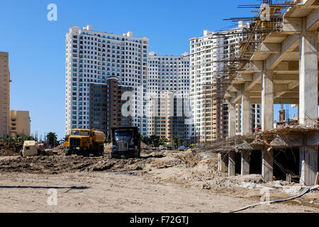 Building under construction, Puerto Vallarta, Mexico with hi rise apartments in the background - Stock Photo