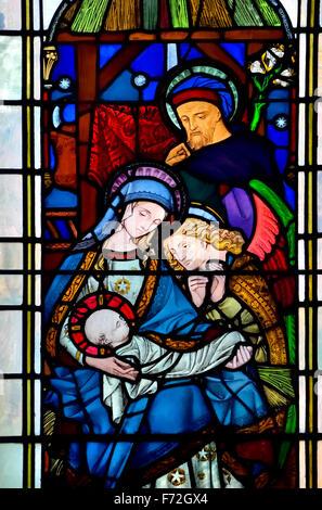 London, England, UK. Parish Church of St Michael Cornhill. Stained Glass Window showing nativity scene - Stock Photo