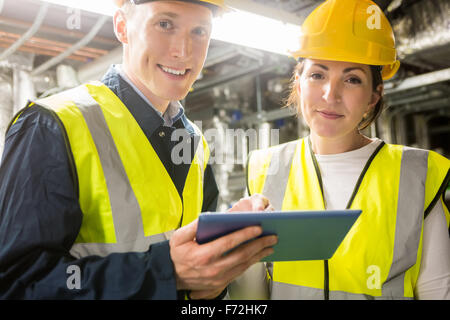 Engineers working in temperature control room - Stock Photo