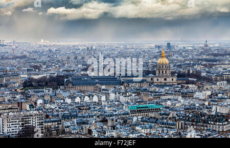 Aerial view of Paris around the Dome des Invalides in a cloudy winter day. - Stock Photo