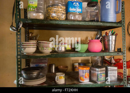 Kitchen shelves in remote Himalayan homestay accommodation - Spiti Valley, Himachal Pradesh, India - Stock Photo