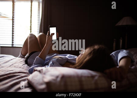 Young woman using smartphone - Stock Photo