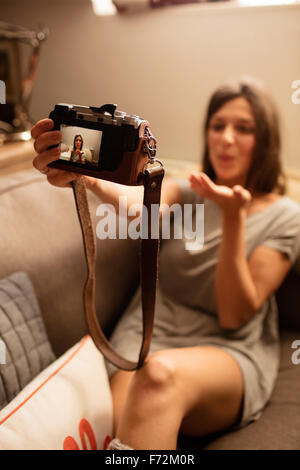 Happy woman taking selfie with camera - Stock Photo
