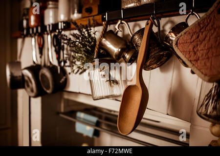 Kitchen utensils hanging on wall - Stock Photo