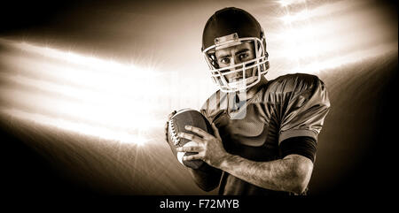 Composite image of portrait of american football player being about to throw football