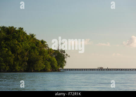 Panorama of the indigenousness people from the Bajo village on the Togean Islands crossing the bridge to the mainland, - Stock Photo