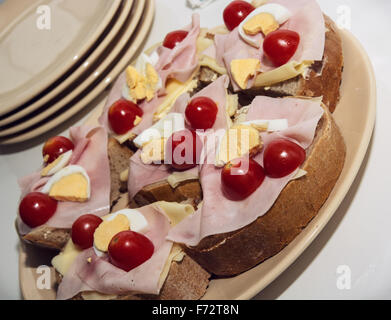 Sandwiches with egg, cheese, ham and cherry tomatoes. Food and drink theme. Breakfast background. - Stock Photo