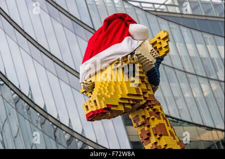 Berlin, Germany. 24th Nov, 2015. A giraffe built out of Lego bricks wearing a red Santa hat in front of Legoland - Stock Photo