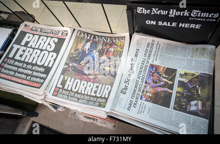 Headlines of New York City newspapers on Saturday, November 14, 2015 report on the previous night's terrorist attacks - Stock Photo