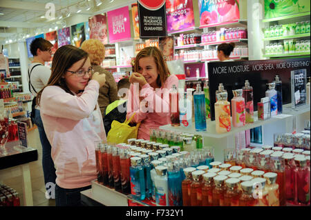 Two pre-teen girls shopping in 'Bath and Body Works' in the Greenwood Mall, Greenwood, Indiana - Stock Photo
