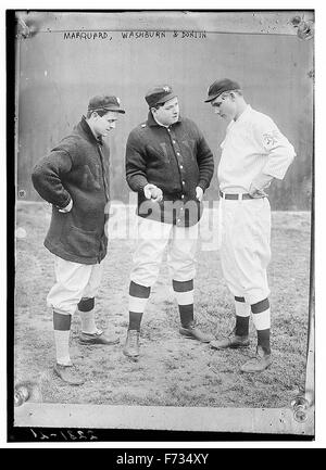 [Rube Marquard standing at right, (Libe?) Washburn in center & Mike Donlin standing at left, New York, NL (baseball)] - Stock Photo