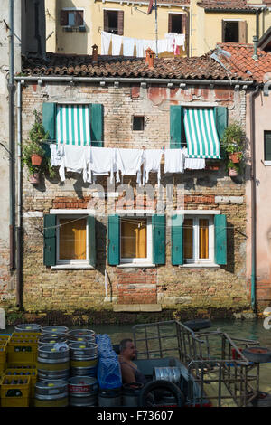 Laundry on washing line in Venice, Italy. - Stock Photo