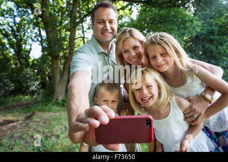 Family with three children, taking a selfie. - Stock Photo
