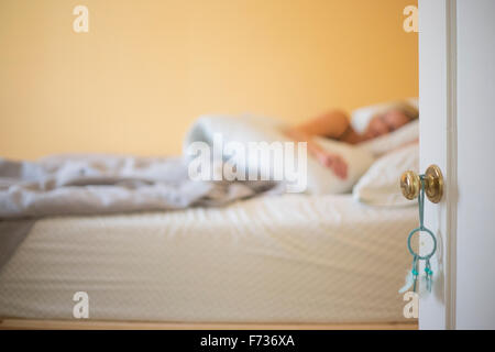 Blond woman sleeping in a bed. - Stock Photo