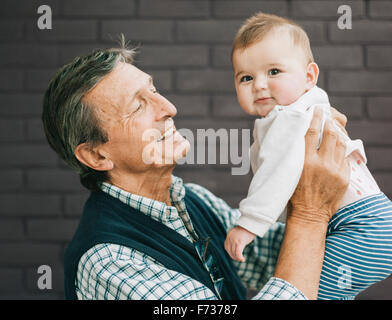 A grandfather and baby granddaughter. - Stock Photo