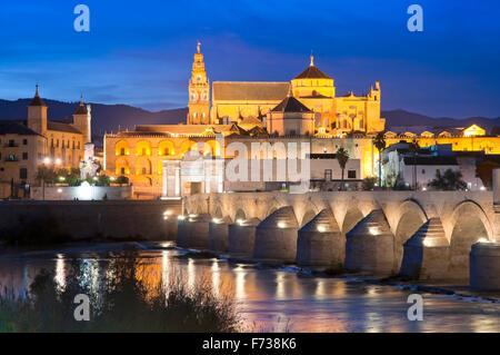 Arab mosque, Roman bridge and Guadalquivir river at dusk, Cordoba, Region of Andalusia, Spain, Europe - Stock Photo
