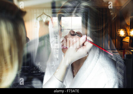 Applying make up to bride - Stock Photo