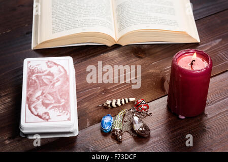 Composition of esoteric objects,candle,cards and book used for healing and fortune-telling. - Stock Photo
