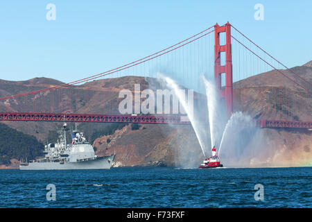 The Arleigh Burke-class guided-missile destroyer USS Ross (DDG-71) is escorted through the Golden Gate. - Stock Photo