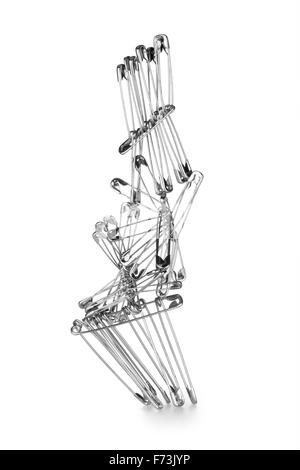 Balancing of safety pin - Stock Photo
