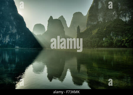 Limestone Karst Formations reflected in River Li Guilin Region Guangxi, China LA007958 - Stock Photo
