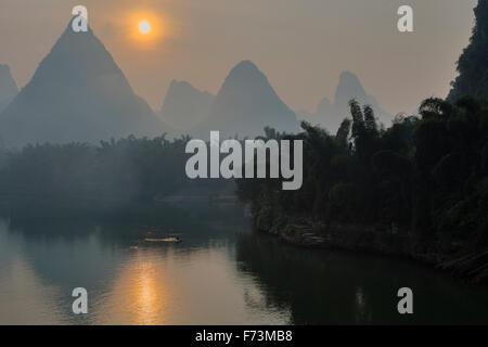 Limestone Karst Formations reflected in River Li Guilin Region Guangxi, China LA007974 - Stock Photo