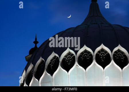 One of the domes on Brighton Pavilion (with moon). - Stock Photo
