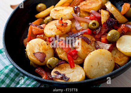 Baked potato with vegetables in a frying pan - Stock Photo