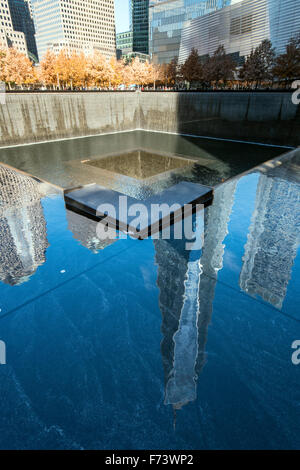 Southern Pool of National September 11 Memorial & Museum with One World Trade Center reflected, Lower Manhattan, - Stock Photo