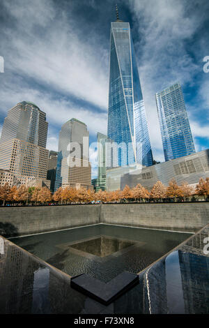 Southern Pool of National September 11 Memorial & Museum with One World Trade Center behind, Lower Manhattan, New - Stock Photo
