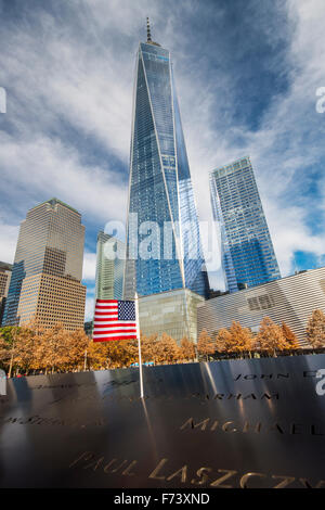 National September 11 Memorial & Museum with One World Trade Center or Freedom Tower behind, Lower Manhattan, New - Stock Photo