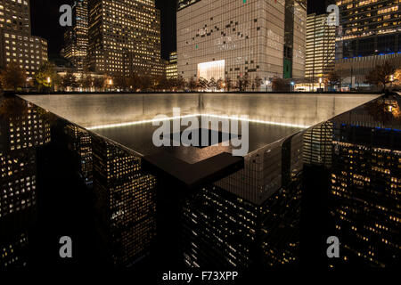 Night view of the Northern Pool, National September 11 Memorial & Museum, Lower Manhattan, New York, USA - Stock Photo