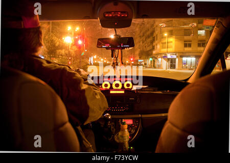 Taxi driver and street in night scene - Stock Photo
