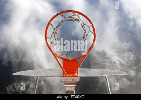 Abstract image of basketball goal against the sky - Stock Photo
