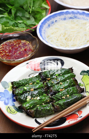 grilled minced beef wrapped in betel leaf, vietnamese cuisine, thit bo nuong la lot - Stock Photo