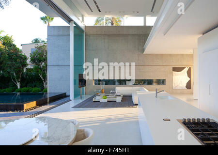 Open plan living and dining room in modern white house, Israel, Middle East - Stock Photo