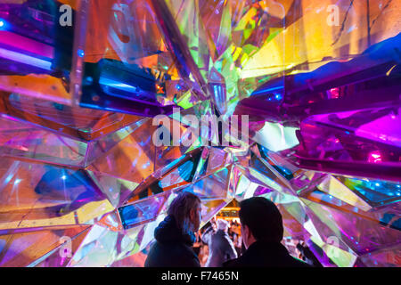 Visitors to Flatiron Plaza in New York on Wednesday, November 18, 2015 interact with 'Nova' created by SOFTLab. - Stock Photo