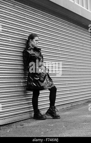 Alternative UK Model In Her Plastic Pvc Coat Mack On A Metallic Industrial Background
