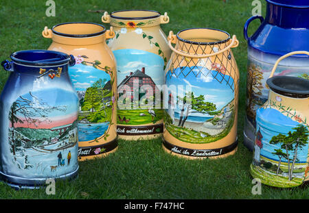 Painted on a milk cans can be seen in Bernitt, Germany, 12 November 2015. Over the past years 200 painted cans have - Stock Photo