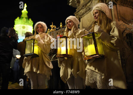 Berlin, Germany. 23rd Nov, 2015. Three young women wearing angel costumes stand in front of Charlottenburg Palace - Stock Photo