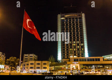 On Taksim place in Istanbul with state flag - Stock Photo