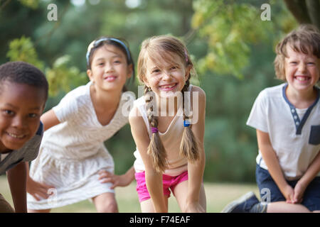 Interracial group of children having fun and smiling - Stock Photo