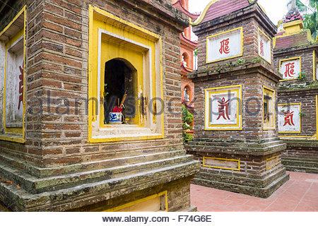 Stupas at Tran Quoc Pagoda (Chua Tran Quoc), Tay Ho District, Hanoi, Vietnam - Stock Photo