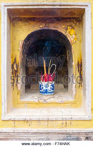 Burning incense at Tran Quoc Pagoda (Chua Tran Quoc), Tay Ho District, Hanoi, Vietnam - Stock Photo