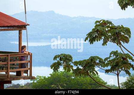 Young woman looks out over the Tuxtlas reserve in Veracruz, Mexico. - Stock Photo