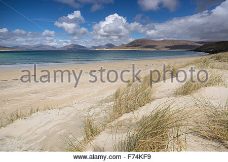 A view from the dunes at Horgabost beach across the sound of Taransay to the hills beyond, Isle of Harris, Outer - Stock Photo