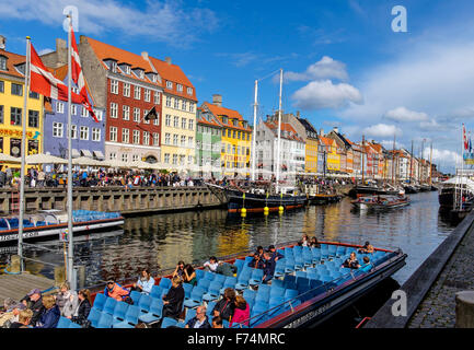 Nyhavn is a waterfront,canal and entertainment district in Copenhagen, Denmark - Stock Photo