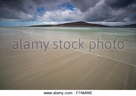 The ebb and flow of the tide at Luskentyre looking across the sound of Taransay to the hills beyond, Isle of Harris, - Stock Photo
